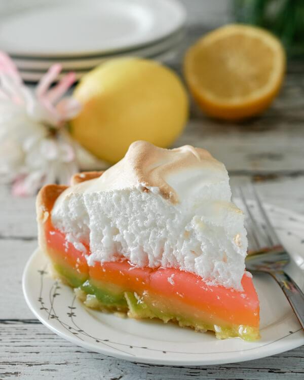 A slice of rainbow colored lemon meringue pie