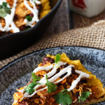 Chili Cheese Polenta. Crispy-edged, creamy-centered polenta topped with chili, cheese, and crunchy crushed nacho chips. No one will ever guess that this chili cheese polenta is a frugal leftover makeover, unless you tell them that is!