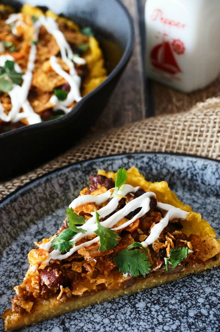 Crispy-edged, creamy-centered polenta topped with chili, cheese, and crunchy crushed nacho chips. No one will ever guess that this chili cheese polenta is a frugal leftover makeover, unless you tell them that is!