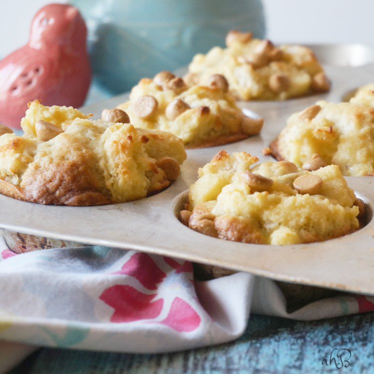 Banana French Toast Muffins,soft and moist banana muffins with a fluffy french toast topping and a sprinkle of peanut butter chips.