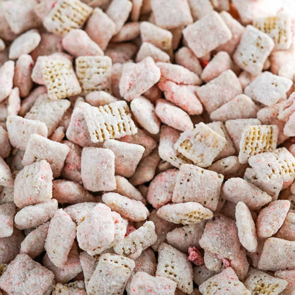 A closeup photo showing the pink cheesecake coating on the rice chex cereal.