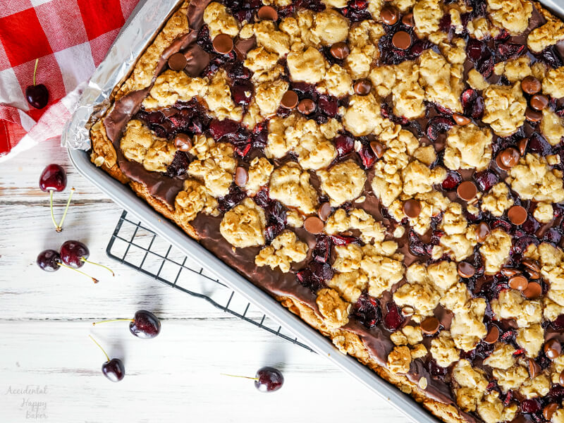 A pan of fresh baked cherry revel bars on a cooling tray.