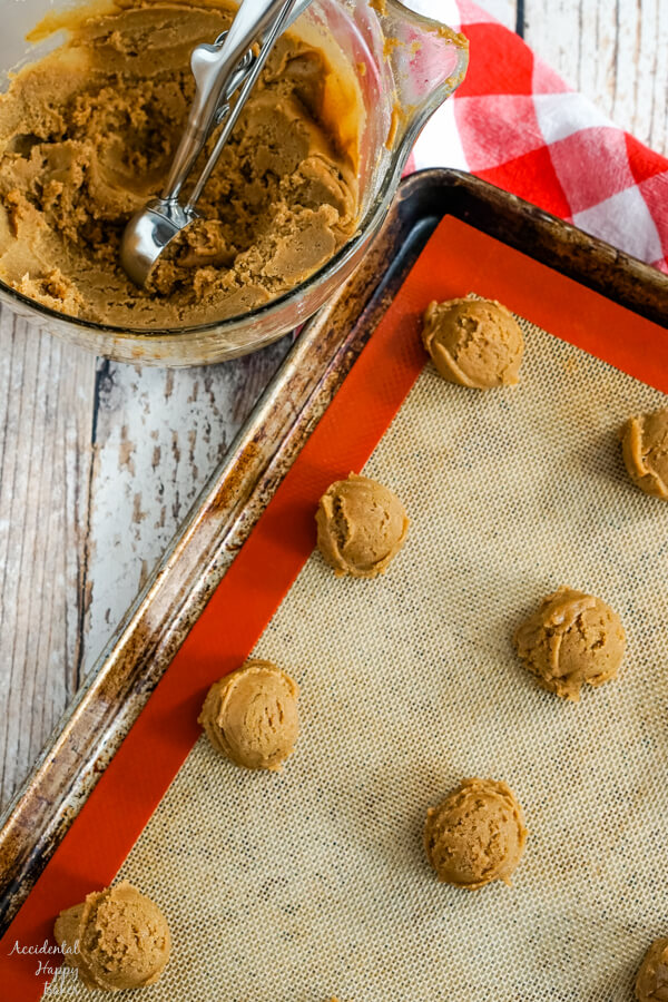 A cookie sheet with mounds of German Gingerbread cookie dough on it.
