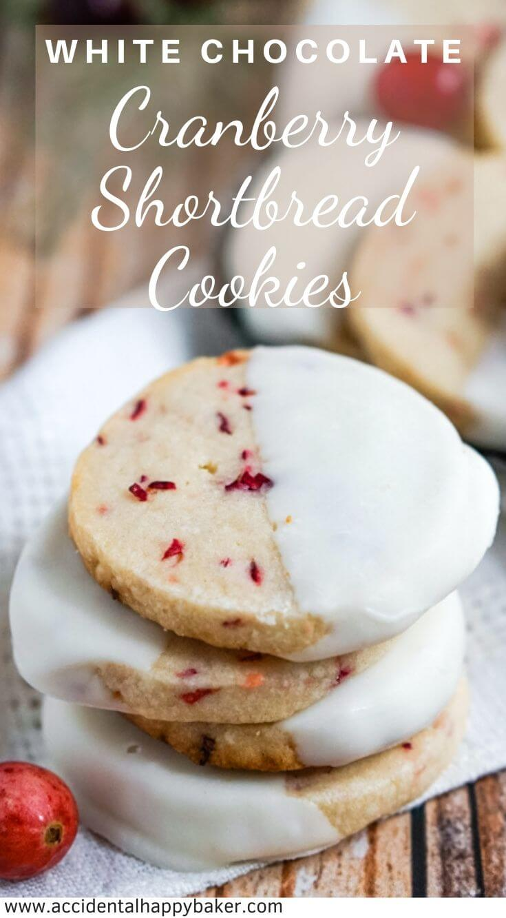 White Chocolate Cranberry Shortbread Cookies have fresh chopped cranberries, a buttery crisp texture, and are dipped in white chocolate. #christmascookies #cranberrycookies #shortbreadcookies