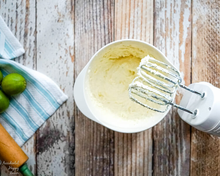 Butter and cream cheese are whipped together as the first step in Key Lime Pie Shortbread Cookies.