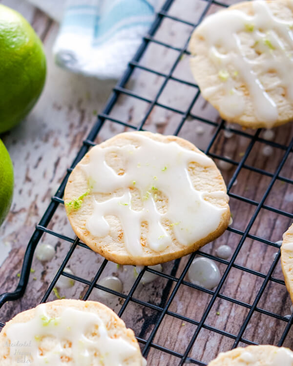A wire rack full of glazed Key Lime Pie Shortbread Cookies