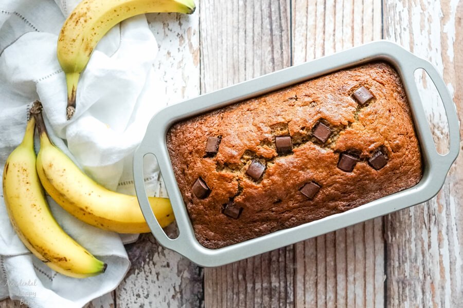 The loaf pan full of banana bread fresh from the oven.
