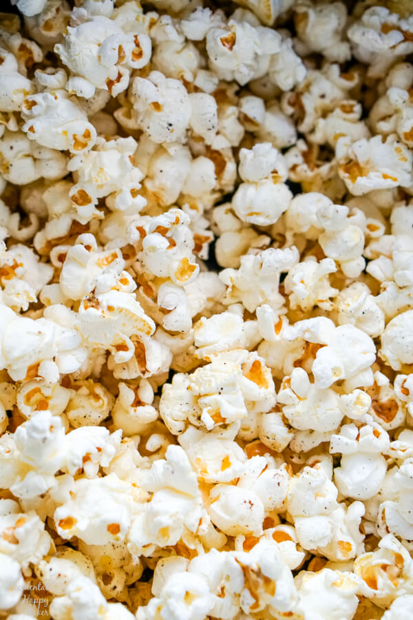 A close up image of the finished popcorn that shows the textures and seasonings.