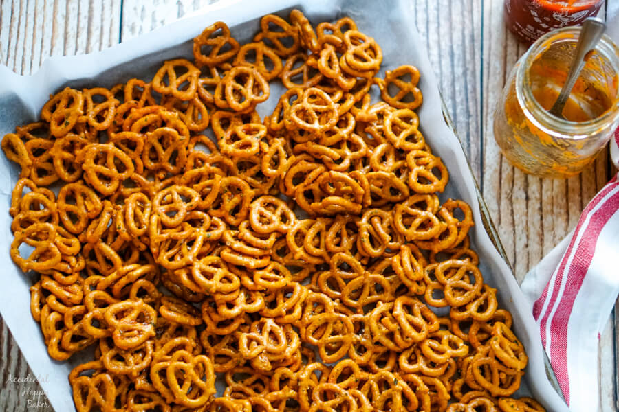 The pretzels are spread out on a baking tray.